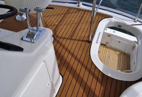 Carpet+fitted+on+boat+-+Teak+with+Black+Caulking