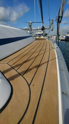 Beautiful side decks and bow synthetic decking on a sailing boat