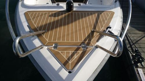 Synthetic decking on bow of motor boat