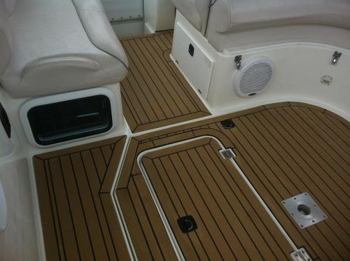 Beautiful marine boat flooring fitted to the cockpit area of a motor boat