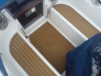 Cockpit area of a sailing boat with Permateek synthetic decking without margins