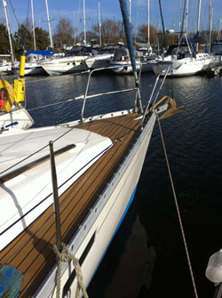 Sailing boat with synthetic decking in Chichester Marina