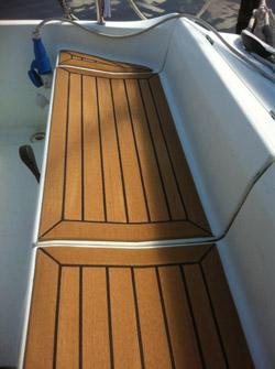 Sailing boat with composite decking, fully margined